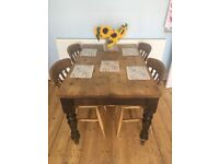 Lovely solid wood antique dining table and four chairs. A perfect addition to any family home