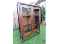 Antique oak bookcase cabinet with barley twist legs