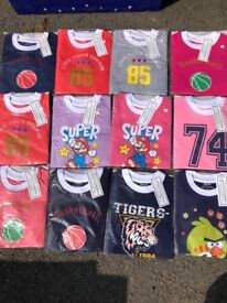 Over 400 brand new kids t shirts in various styles and sizes, picture shows a few examples