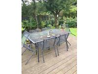 Outside table and chairs, good condition.