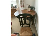 Wooden extending table and four chairs