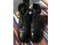 Black leather boots size 8.