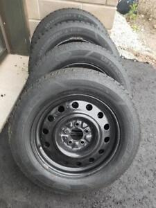 LIKE NEW FORD MUSTANG GOODYEAR ULTRAGRIP  WINTER TIRES  215 /  65  / 17 ON STEEL RIMS.