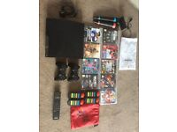 PS3 with singstar, Buzz, 2 controllers, 9 games and remote control