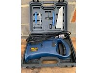 Reciprocating Saw, in Box with Extra Blades, Hardly Used.