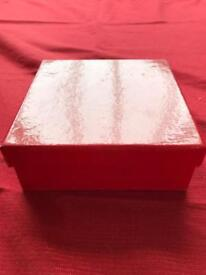 Small red cardboard box.