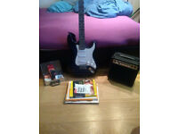Guitar beginners package (guitar, amp, instructional booklets/cds, accessories)