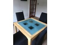 Glass top extending dining table and 4 chairs