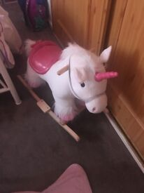 Pink unicorn rocking horse with sounds