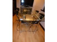 Quality glass and chrome table with 4 chairs
