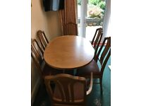 Extendable Teak Dining Table and Six Chairs