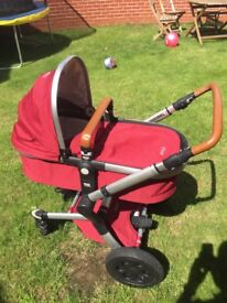 Joolz Buggy Lobster Red with Maxi-cosi car seat.