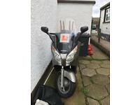 Honda swing 125cc moped. Low miles cheap