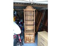 Mexican pine tall unit with 4 shelves, 1 drawer and double doors.