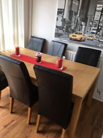Stunning table and 6 leather chairs as new