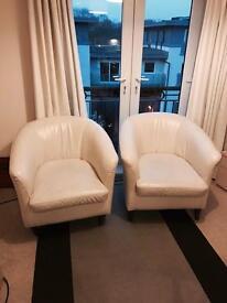 2 cream leather bucket armchairs