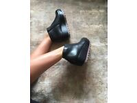 Camper ankle high black leather boots