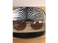 Beautiful genuine Roberto Cavalli sunglasses with original case. Lenses have a brown tint.