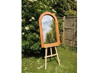 Solid oak round arched mirror.