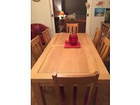 Oak dining table and 6 chairs. Very good condition sold as seen buyer collects cash on collection