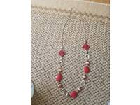 Long red and silver necklace