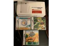 Boxed white Nintendo dsi with games