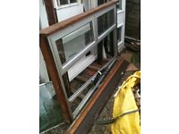 Alloy window with clear d/glazed glass and 2 top openers (has h/wood outer frame)