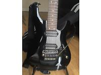 Ibanez S7420 with DiMarzio Dsonic and Liquifire Dunlop straplocks and a gigbag