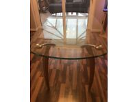 Glass topped dining table.