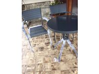 Modern Rattan Effect bistro patio set with chairs new in box.