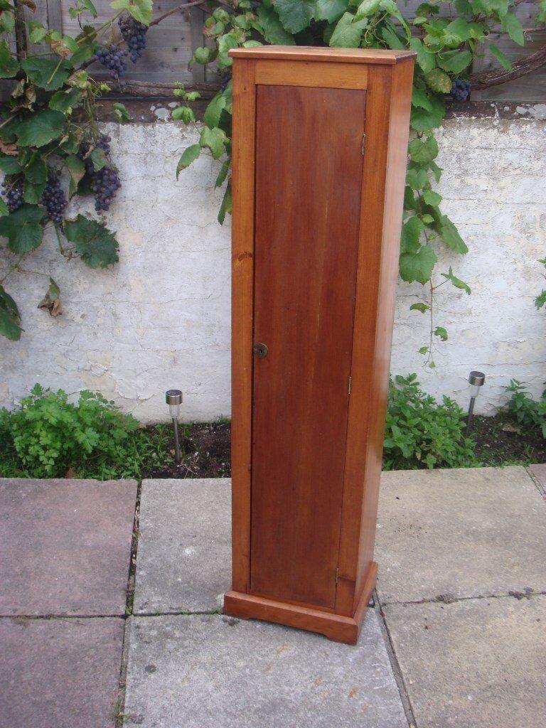 Tall wooden cupboard