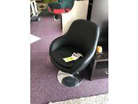 Brand new black swivel chair