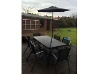 Set of Table, 6 chairs and umbrella with foot for the garden