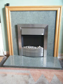 Green marble fire surround with matching hearth stone.