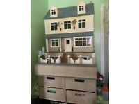 Dolls House - With Basement and 4 drawer Stand. Decorated and has electric lights.