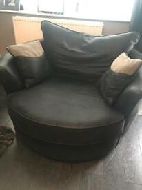 Black and grey swivel cuddle chair