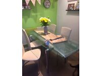 Dinning ext table and 4 chairs