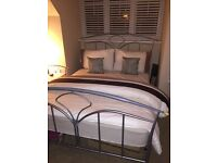 Metal double bed with matching bedside table
