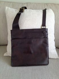 Zip top cross body bag in soft brown leather.