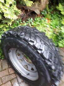 Tyre Sahara 4 x 4 235/85 R16 sitting on 16 inch rim. Worn but still plenty of tread.