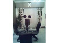 Glass dinning table with 4 brown leather Z chairs