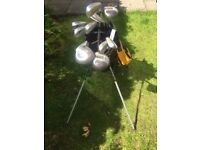 Golf clubs with carry on shoulder strap