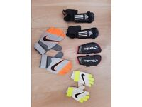 NIKE FOOTBALL GLOVES and shin pads FOR BOYS. size 4 and size 7. Approx ages 4-7 and 8-11