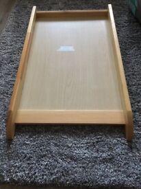 Wooden cot top changer.