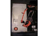 BRAND NEW / STILL BOXED LAWN MOWER AND STRIMMER