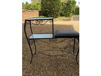 Wrought iron telephone table with glass shelves and padded seat, SM6 area.