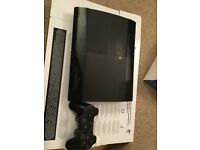 Sony PS3 Slim 12GB + controller, cables and 15 games