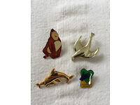 4 badges, brooches, pins: Children's Promise, gorilla/ape, dolphins, bird. Happy to post. £5 the lot