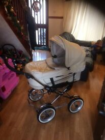Bespoke emaljunga pram. Tubed tyres 4way independent suspension loads of features.needs to be seen.