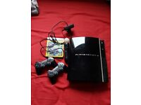 80GB PS3 with 2 controlers, move controller and LBP2 game